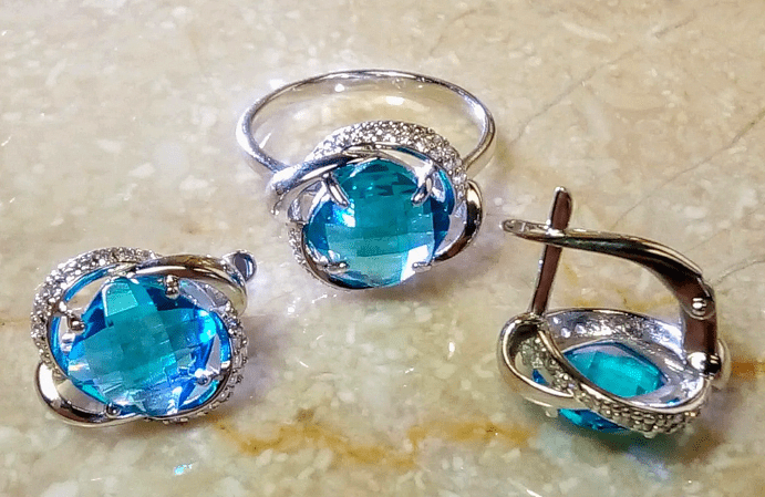 Примеры украшений с турмалином Параиба. Комплект кольца и серьги