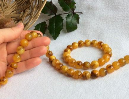 Как выбрать украшение «Желтый глаз тигра» из янтаря, особенности ухода